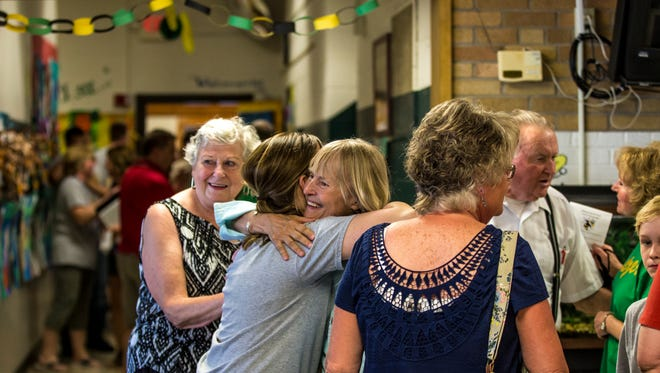 Attendees greet each other during Vesper Community Academy's open house on May 24, 2018, in Vesper, Wis.