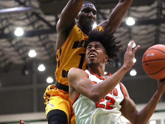 FAMU's Marcus Barham blows by Bethune-Cookman's Soufiyane