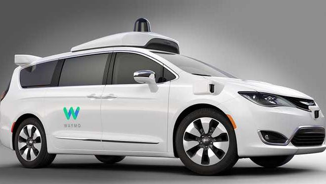 A white Waymo self-driving car