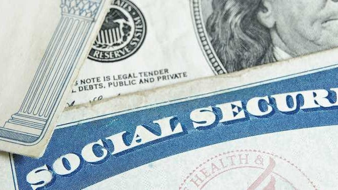 Two social security cards and money.
