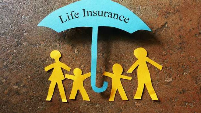 A paper cutout family under an umbrella that reads life insurance.