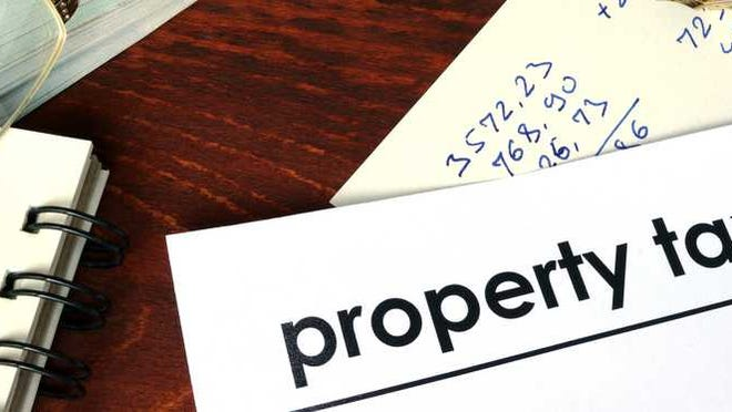 Corner of paper that says property tax.