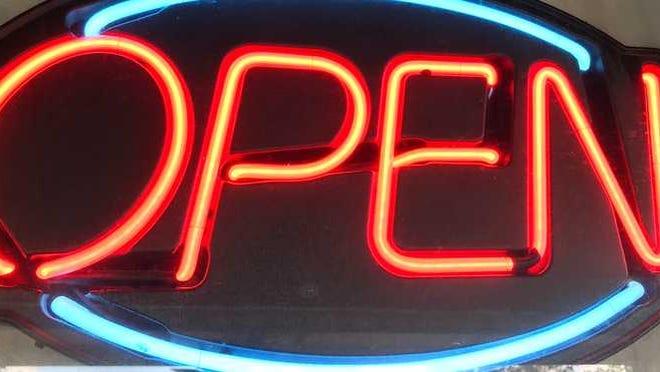 Neon Open sign lit up.