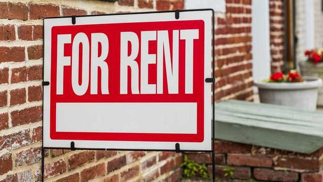 For Rent sign in front of a residential building.