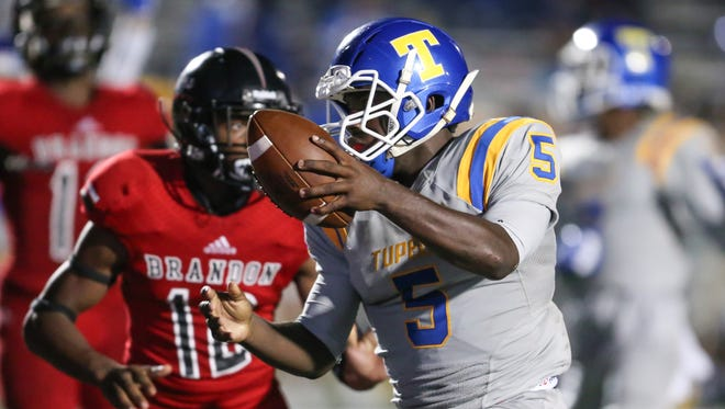 Tupelo High School's Jaquerrious Williams (5) scores a touchdown in the third quarter. Brandon and Tupelo played in an MHSAA Class 6A football game on Friday, September 8, 2017 at Brandon. Photo by Keith Warren