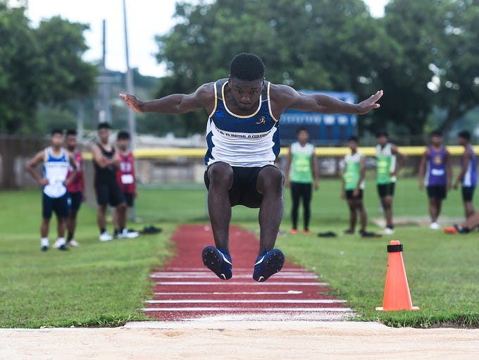Guam High's Khalid Volious, 18, competes in a long