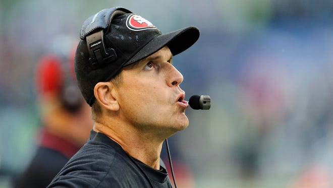 San Francisco 49ers head coach Jim Harbaugh looks up at the scoreboard in what turns out to be a 29-3 loss to the Seattle Seahawks on Sept. 15.