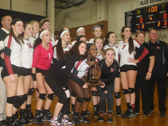 Members of Churchill's volleyball team pose for a photo