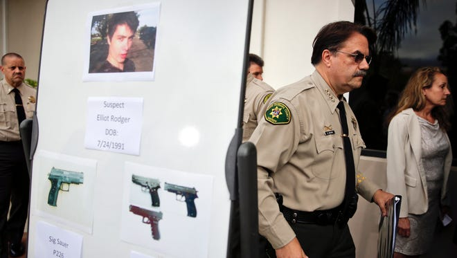 A board shows photos of shooter Elliot Rodger and weapons used in a mass shooting in May.