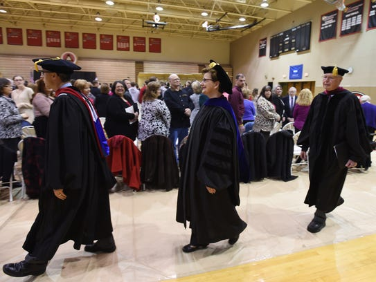 Dr. Susan S. Hasseler is escorted to the stage before