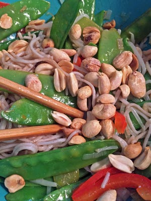 Dry roasted, unsalted peanuts garnish snow peas with bean sprouts and red bell peppers over soba noodles