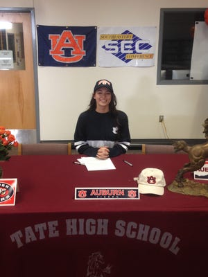 Tate's Casey McCrackin signs letter of intent to play softball at Auburn University on Friday at Tate High School.