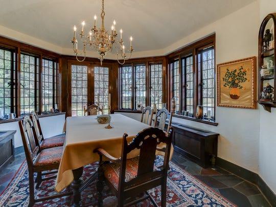 The breakfast room offers leaded glass windows.