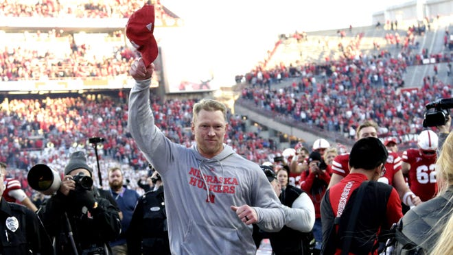 Nebraska head coach Scott Frost tips his cap to spectators as he runs off the field following the team's first win of the season in an NCAA college football game against Minnesota in Lincoln, Neb., Saturday, Oct. 20, 2018. (AP Photo/Nati Harnik) ORG XMIT: NENH112