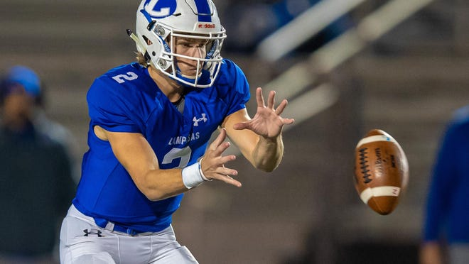 Lampasas quarterback Ace Whitehead, taking a snap against Brazosport during a playoff game last fall, accounted for 253 yards and four TDs in Friday's 41-0 victory over Stephenville.