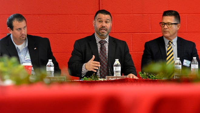 Flanked by state Rep. Seth Grove, R-Dover Township, left, and state Sen.-elect Mike Regan, R-Dillsburg, right, Pennsylvania Secretary of Education Pedro Rivera visits Dover Area High School, Thursday, Dec. 8, 2016. John A. Pavoncello photo