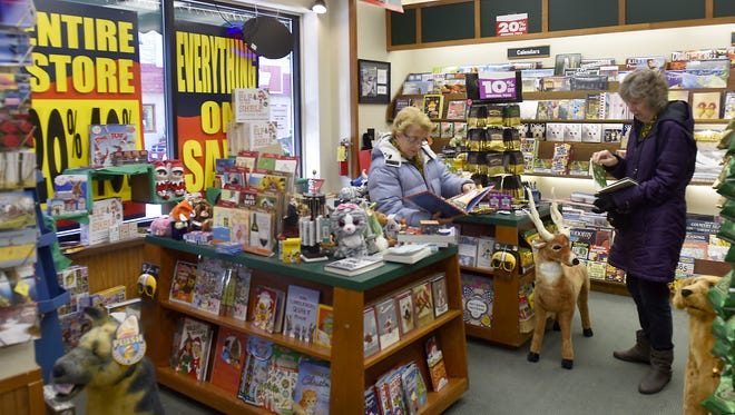 Donna Bykoski of Sturgeon Bay and Bev Schilz of Delafield look over children's titles at Book World, 30 N. Third Ave., Sturgeon Bay. The store plans to close in mid-January.