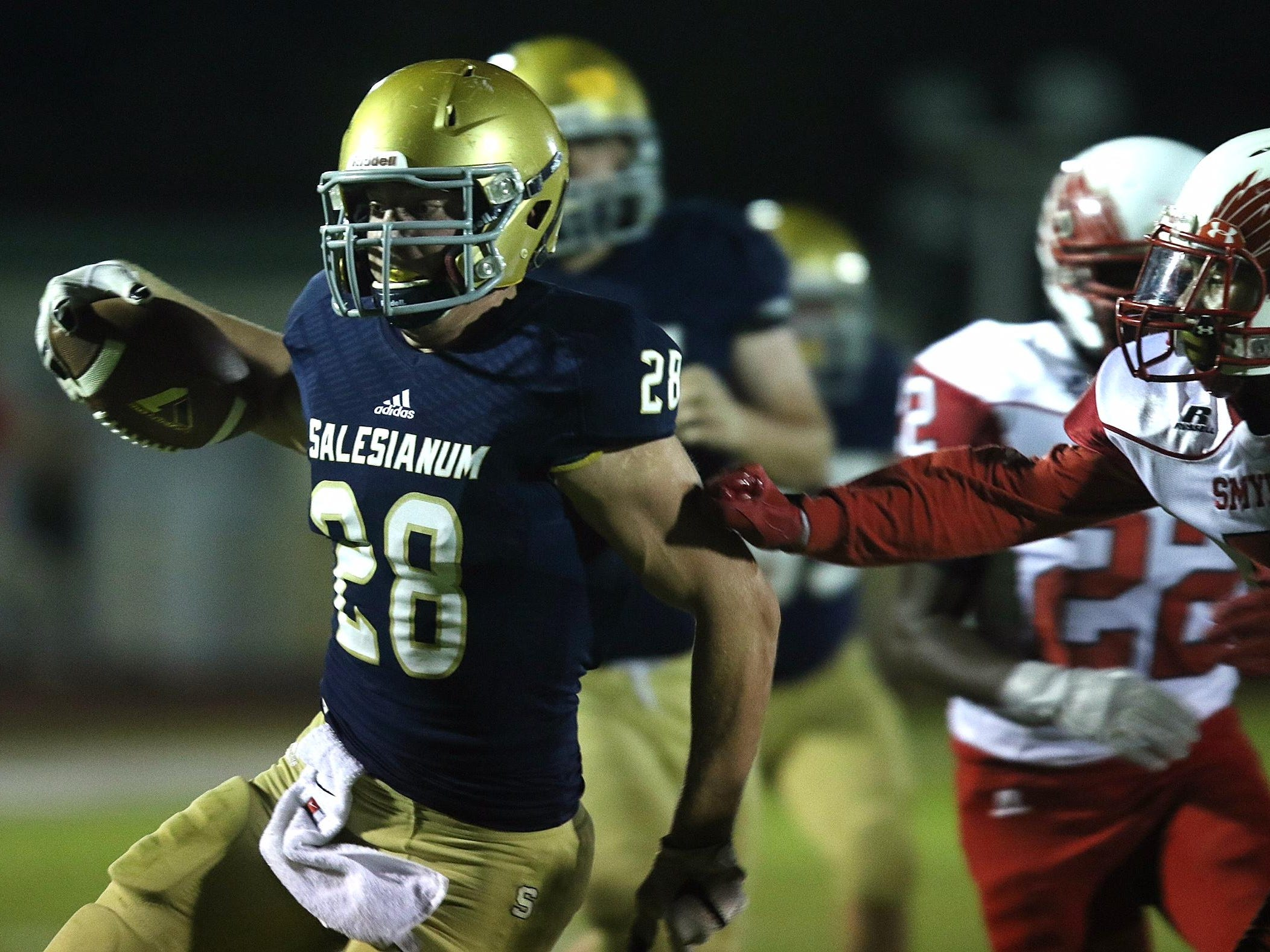 Salesianum senior Colby Reeder breaks away for a first-quarter touchdown run in Friday night's game against Smyrna at Baynard Stadium.