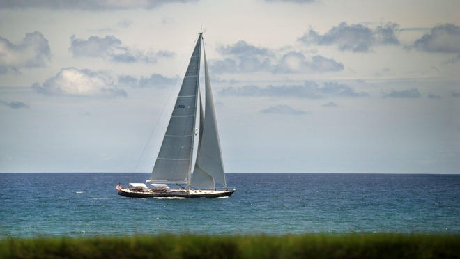 A large sailboat sails off the coast of Palm Beach last week. Temperatures will climb into the low 90s today, with no rain in the forecast.