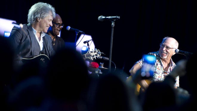 Jon Bon Jovi and Jimmy Buffett in a performance in February 2019 during an Everglades Foundation dinner dance at The Breakers.