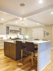 The modern kitchen is made for cooking and entertaining.