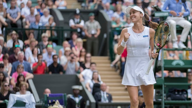 Martina Hingis celebrates match point during the mixed doubles final against Henri Kontinen (FIN) and Heather Watson (GBR) at Wimbledon on July 16. She and Jamie Murray won the title.