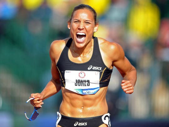 Lolo Jones celebrates after placing third in the women's