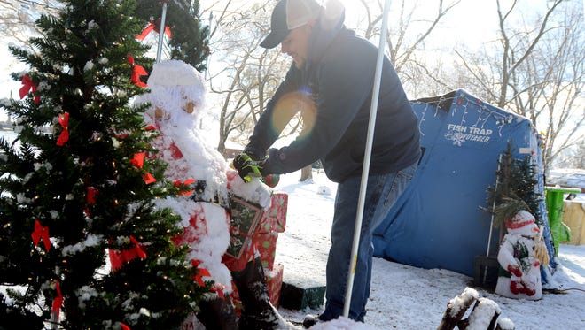 Dan Shirkey tends to his display sponsored by Shirkey Electric, Monday, Nov. 16, at Marysville City Park.
