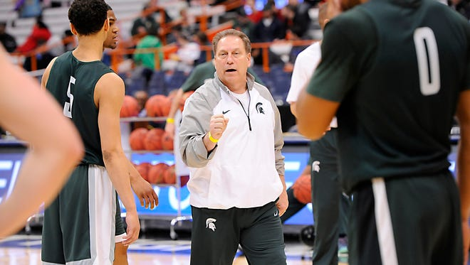 MSU head coach Tom Izzo gives instructions to his team for a drill  during the Spartans' NCAA practice in Syracuse, N.Y., on Thursday.