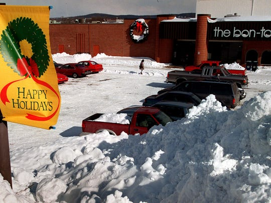 Piles of cleared snow at a Bon-Ton store days after the blizzard hit.