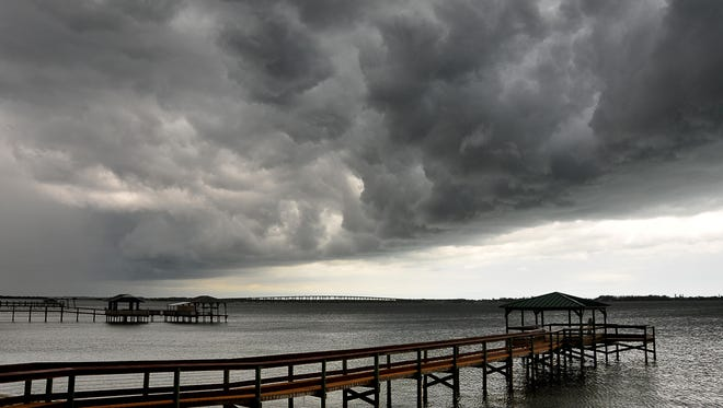 Around 1:00 p.m.thunderstorms and rain rolled into Brevard. Dark clouds that  brought rain hang low over the Indian River, viewed from Shore Side Park in Palm Shores.