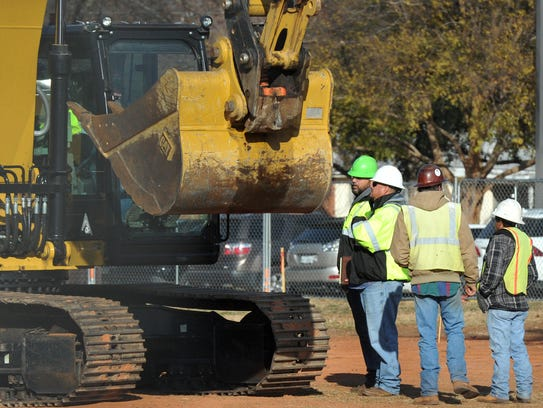 Construction workers look to break ground on the university's