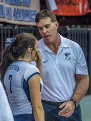 Piedra Vista head coach Ron Becker talks to senior Alex Johnson after PV was eliminated from the 5A volleyball tournament Friday at the Santa Ana Star Center in Rio Rancho.