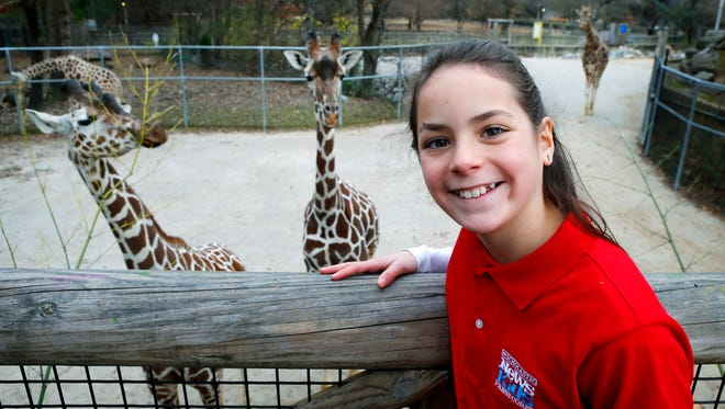 December 16, 2016 - Sadie Kiel, 10 stands near the giraffes at the Memphis Zoo. Kiel is among a couple dozen kids, and the only child in Tennessee, who has been accepted in the Scholastic News Kids Press Corps through their Kid Reporter program. For her application to the program she did a story on the Memphis Zoo's giraffe program.