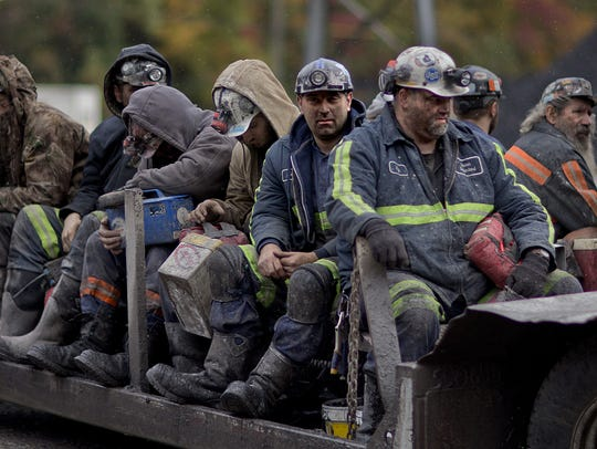 AP In this Oct. 15, 2014, photo, coal miners return