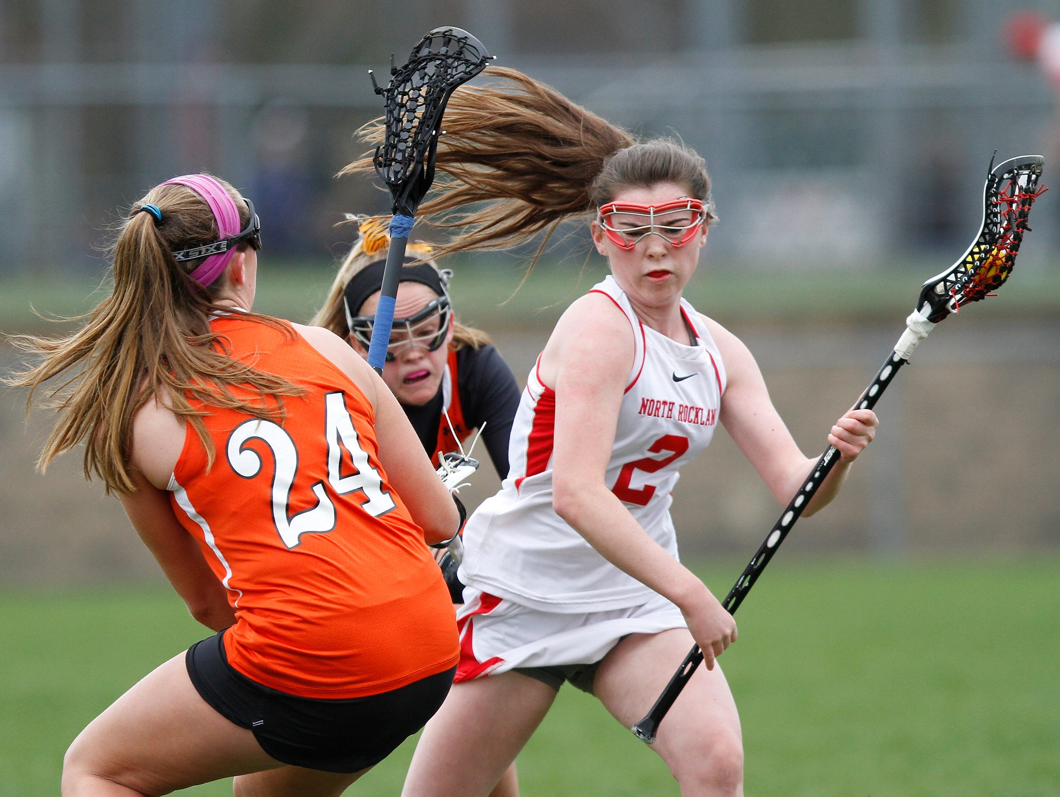 North Rockland's Elizabeth Fox (2) works the ball around Mamaroneck's Cassie Budill (24) during a girls lacrosse game at North Rockland High School in Thiells on Saturday, April 02, 2016.