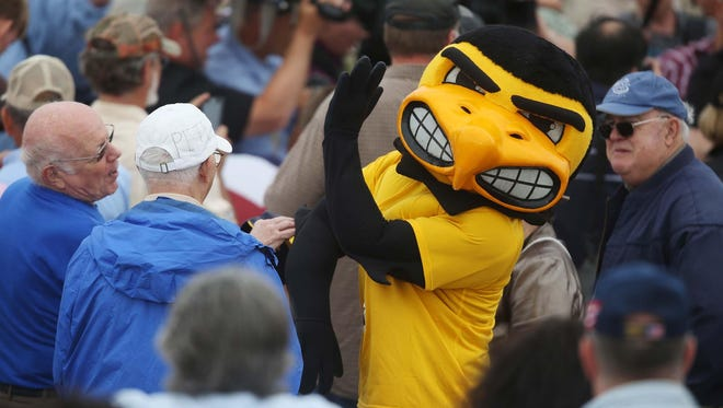 Herky, the University of Iowa mascot, makes his way through the crowd before the start of the first Roast & Ride, a fundraiser for U.S. Sen. Joni Ernst, on June 6 at the Central Iowa Expo grounds in Boone.