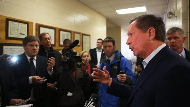 Ohio Gov. John Kasich, who plans to launch his presidential bid July 21, will attend the MLB All-Star Game next week. Here, Kasich talks to a group of reporters on a 2016-related trip to New Hampshire in March.