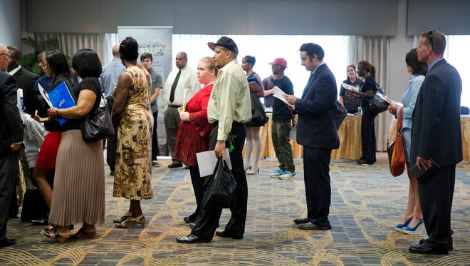People wait in line to meet with recruiters during a job fair in Philadelphia.