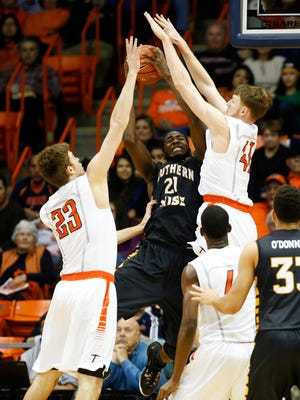 Jan 10, 2015; El Paso, TX, USA; Southern Miss Golden Eagles forward Norville Carey (21) tries to shoot over UTEP Miners center Matt Willms (41) and UTEP Miners center Hooper Vint (23) at the Don Haskins Center. Mandatory Credit: Ivan Pierre Aguirre-USA TODAY Sports