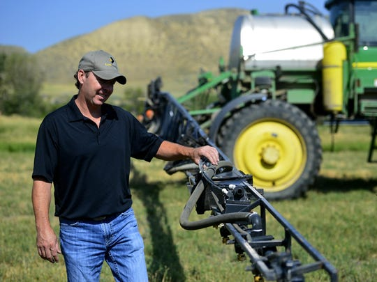 Trampus Corder of Corder and Associates checks a sprayer he uses for his agriculture spraying business in Fort Benton.