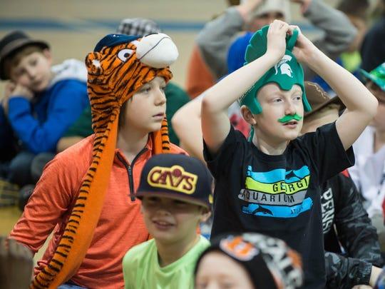 Harper Creek fifth-graders Zack Tramel, left, and Kennedy Cunningham wear hats for a fundraiser for Abigal Kopf on Friday at Harper Creek Middle School.