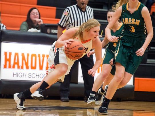 Hanover's Avery Martz runs the ball up the court, Friday,