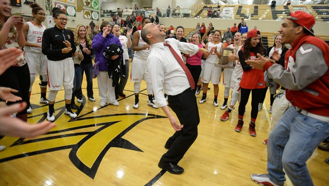 Richmond coach Casey Pohlenz takes over a celebratory dance circle after the girls basketball team defeated Connersville for the class 4A girls basketball sectional championship Saturday, Feb. 14, 2015, in Fortville.