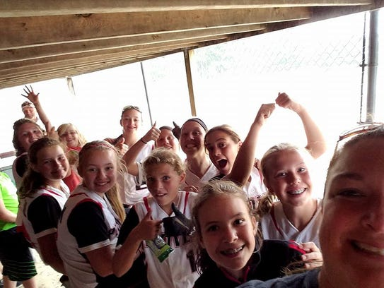 The 12's pose for a picture during a rain delay while