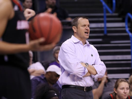 U of L head coach Jeff Walz instructed his team during