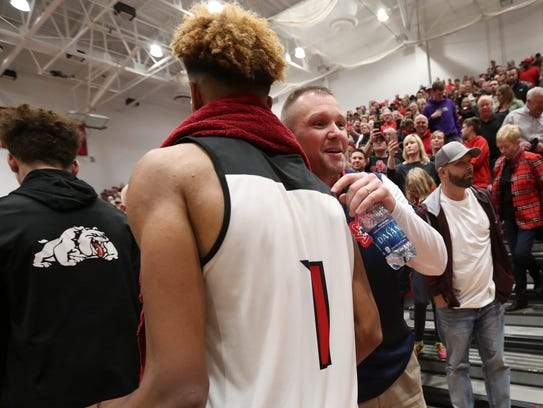 New Albany's Romeo Langford (1) was greeted by Bedford