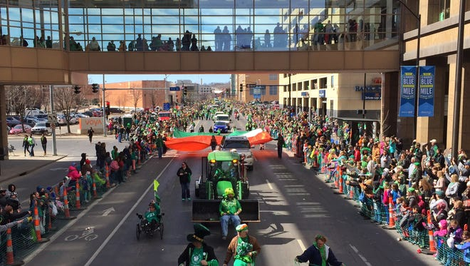 The St. Patrick's Day parade moves slowly through downtown Des Moines on Tuesday.