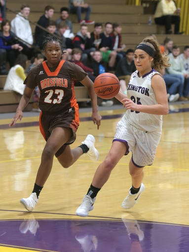 Lexington's Gabby Stover dribbles the ball in front
