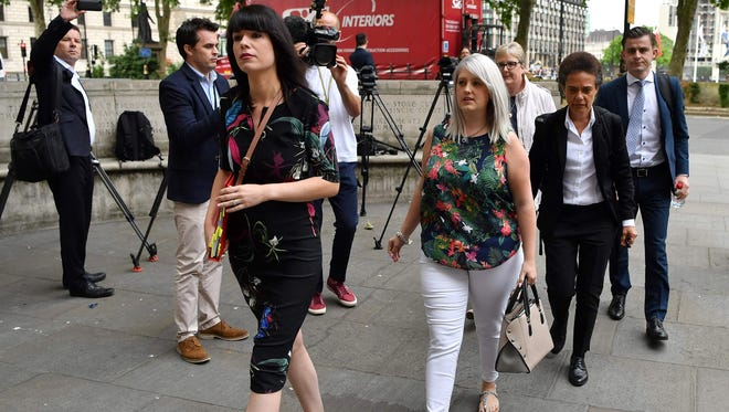 Northern Ireland resident and campaigner Sarah Ewart (4th right), who after having been diagnosed with a fatal fetal abnormality in 2013 traveled to England for a termination, arrives at the Supreme Court in London on June 7, 2018. Britain's Supreme Court on Thursday said it could not rule on an appeal against Northern Ireland's strict abortion laws, but that it would have declared them incompatible with human rights laws otherwise.